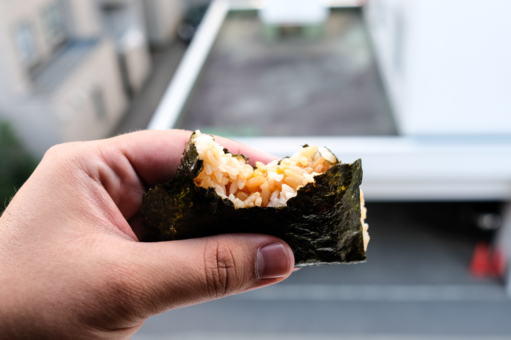 Sorry, I took a bite so you could see inside of the tamago kake musubi (¥120/$1.20).