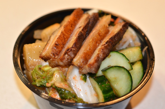 Seoul Bowl: Crispy pork belly, housemade banchan, 64-degree egg, steamed rice