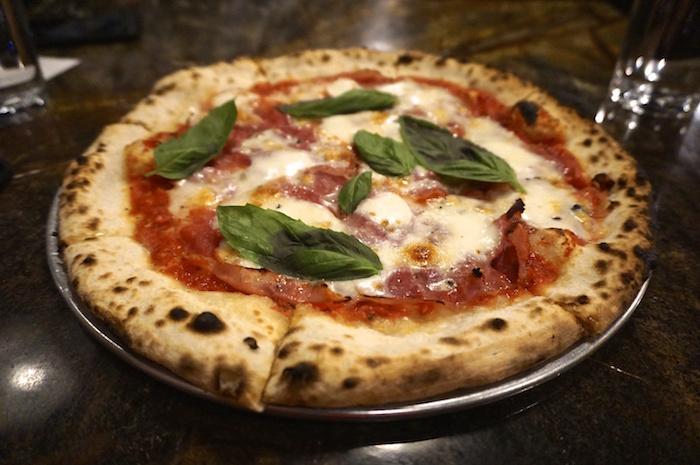 Proscuitto, truffle, basil pizza