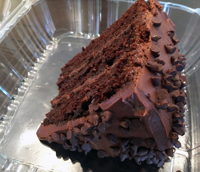 This dessert features three thick layers of chocolate cake, silky chocolate buttercream frosting and chocolate chips.