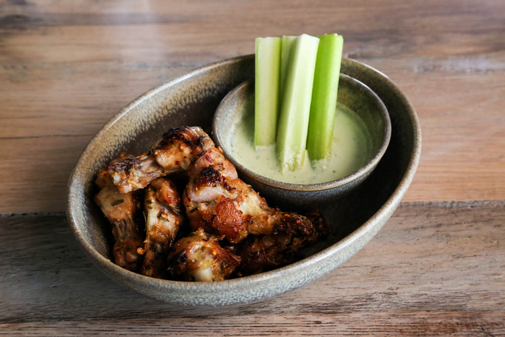 Wood-roasted jidori chicken wings with garlic, rosemary and a cooling tzatziki sauce ($14)