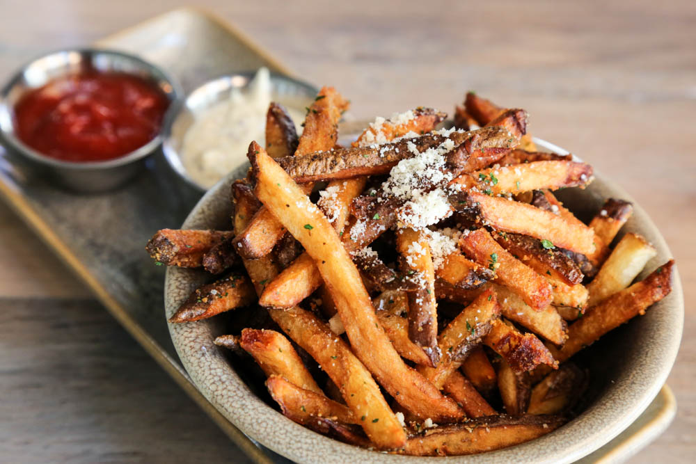 The garlic truffle hand cut fries ($8) are great to munch on with any of the 30+ craft beers on tap. $4 on happy hour.