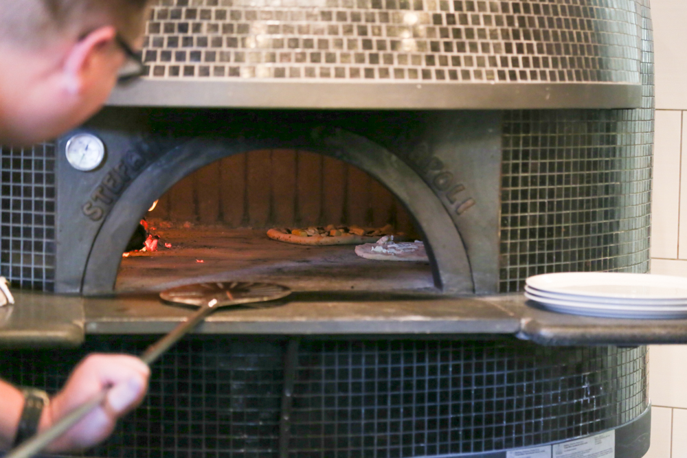 The oven was built piece by piece inside Brick Fire Tavern from materials from Naples, Italy by third generation builder, Stefano Ferrara.