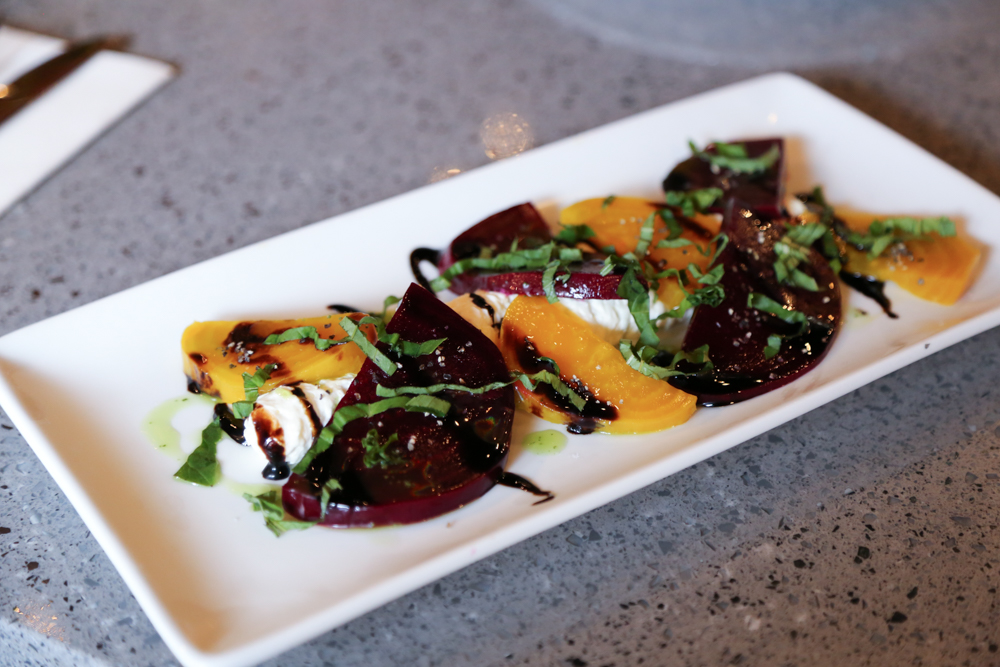 Besides pizza, Brick Fire Tavern also serves up apps and desserts like this beet caprese salad ($8).