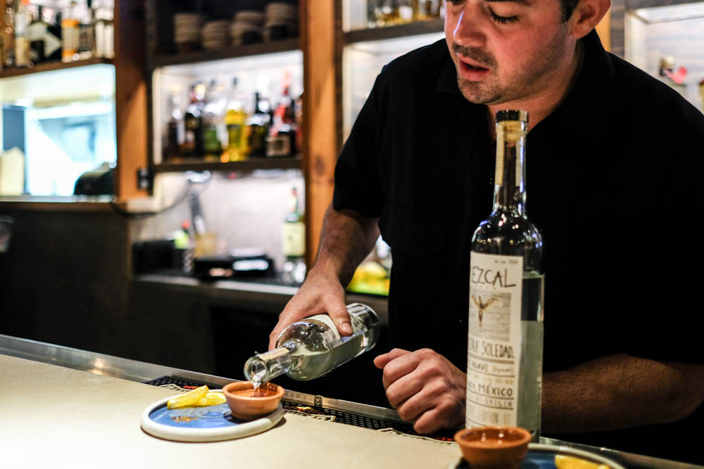 Quinn insists on serving mezcal in copitas, little terra cotta cups, with orange segments and chile salt.
