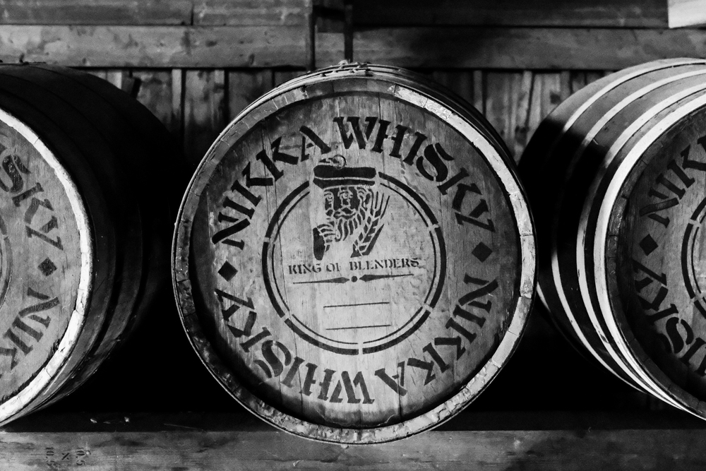 Inside the dark storehouse, you'll find rows and rows of barrels just like this. Today, Nikka Whisky ages its product in various locations throughout Japan.