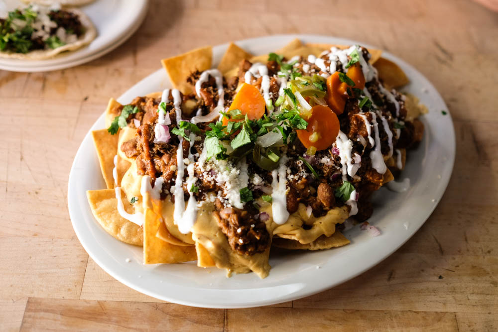 Now that's what I'm talking about. The Grime Time nachos ($12) come stacked with tex-mex queso, beans, cilantro, salsa roja, pickled jalapenos and can be kicked up a notch with pork or chicken ($3) or beef ($3.75).