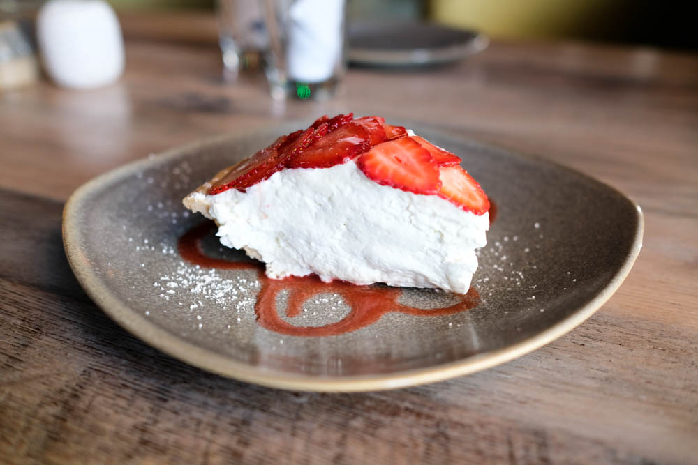 A thick slice of strawberry pie ($8) with a creamy filling and guava drizzle over top.