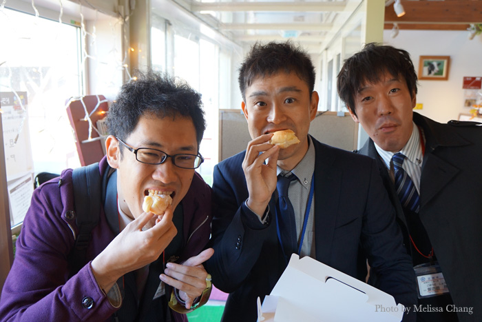 Our guides from Ebetsu: Eiji, Taro and Gobo indulging in a box of donuts.