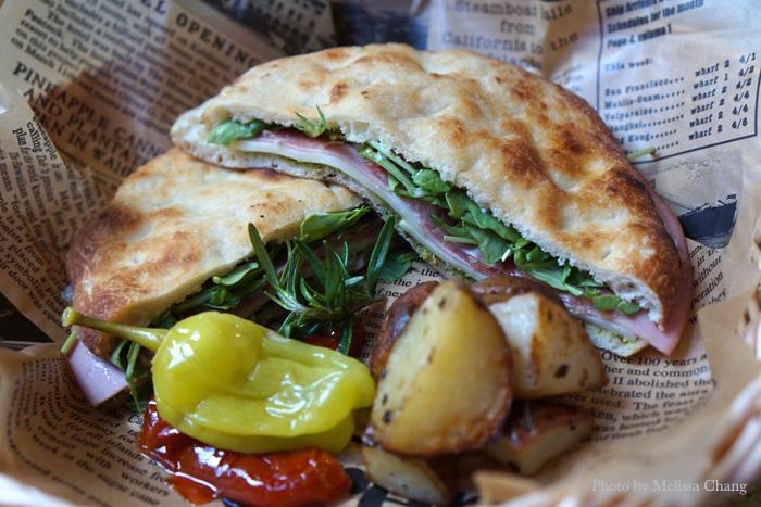 """Another new """"breakfast in bread"""" item: panino con affetato misto ($12.95), a sandwich with mortadella ham, prosciutto, salami, arugula, fresh mozzarella and Genovese pesto. This is thin but very filling!"""