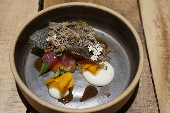 """Gregory Gourdet has Haitian roots, so he's familiar with poke. Here, he took fresh ahi cubes and put his twist on it with fermented heart of palm, nori tuile, paper-thin slices of dried papaya, and a sprinkle of black truffle """"because I feel like celebrating."""" It was definitely a celebration in my mouth!"""