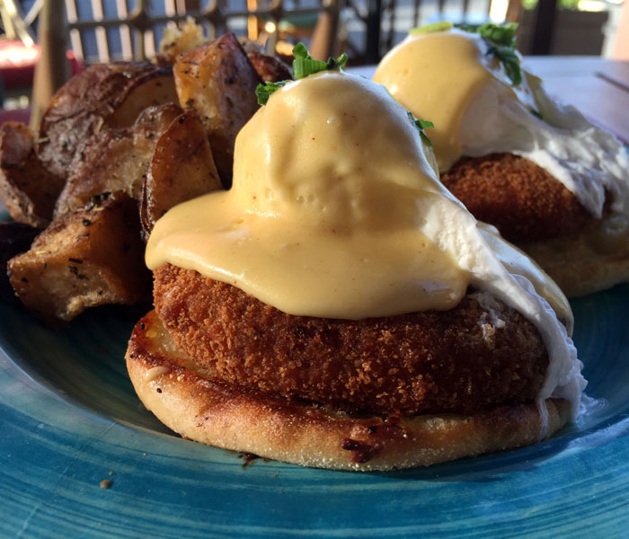 These generously sized crab cakes are fried to a perfect golden brown and come topped with poached eggs and hollandaise sauce on an English muffin.
