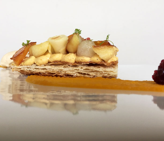This puff pastry is topped off with kabocha cheesecake, candied Maui persimmons, white wine poached pears and Miso apples. It comes with a delicate scoop of dulce de leche ice cream.