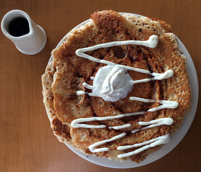 Imagine your favorite cinnamon rolls … but in larger-than-life pancake form.