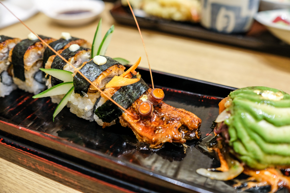 The dragon roll ($25) is definitely all show. It's Katsumidori's showpiece roll with unagi, shrimp tempura, maguro, avocado and a ball of salmon poke. Photo by Thomas Obungen