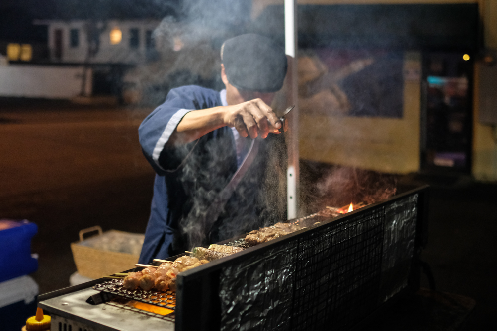 Chris Quisote, Hawaii's own salt bae, sets up Da Ala Cart tent around 9 pm in the Launderland parking lot on Beretania Street, to grill kushiyaki for a motley crew of patrons. Chris posts his menu on Instagram early in the day to announce his opening and offerings.