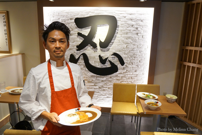 Nin Nin Curry manager Shohei Nakamura with a plate of tonkatsu curry ($13.50).