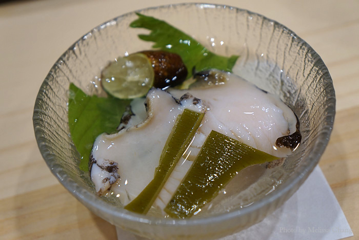 More Kona abalone, this time salted, shucked and sliced right before us. The dashi isn't for drinking, but with the mix of herbs and finger limes, it makes the abalone taste like it came right out of the ocean. You can eat the konbu, which is imported from Hokkaido.