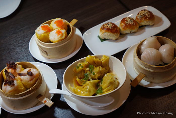 Clockwise from left: Phoenix tail shrimp shumai, scallop shumai, venison puffs, har gau, pork dumplings with spicy sesame oil.