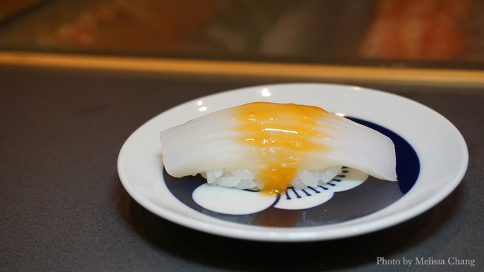 Tender ika nigiri topped with ibaragani (a kind of Hokkaido crab) eggs that aren't hatched or fertilized.