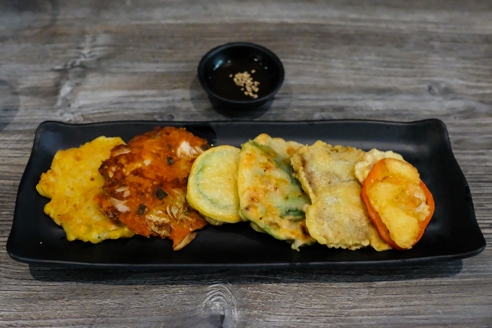 You'll do good by starting with a jeon platter for $9 and includes six mini jeon pancakes. You may choose between beef, kimchi, green onion with squid, shrimp with paprika, zucchini and corn or have them all like a sampler.