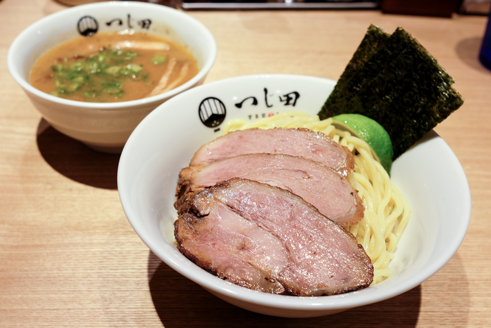 The chashu tsukemen is topped with three additional tender slabs of roast pork.