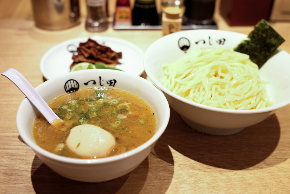 The regular ajitama tsukemen ($12.98 or $11 with kamaaina discount) includes thin strips of chashu pork, menma (bamboo shoots) and a marinated soft boiled egg. A smaller portion of noodles can be had for a dollar less.
