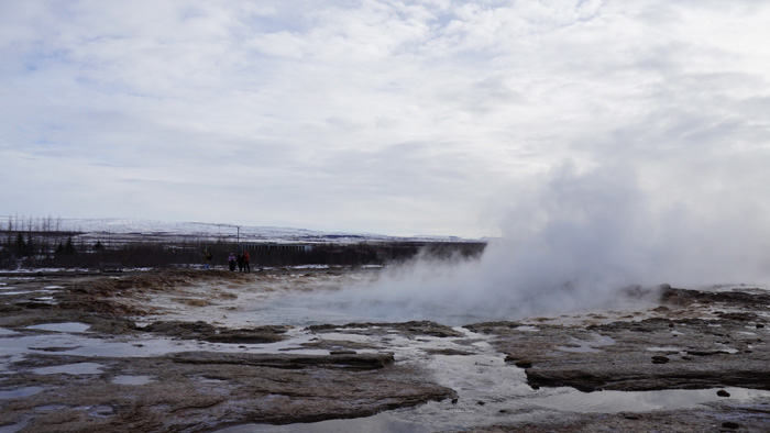 Steam billowing from one of the hot springs in Geysir.