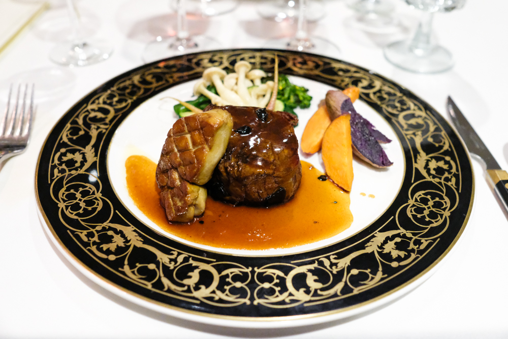 Our entree consisted of a kiawe grilled 7 oz filet mignon and a generous slab of perfectly seared foie gras.