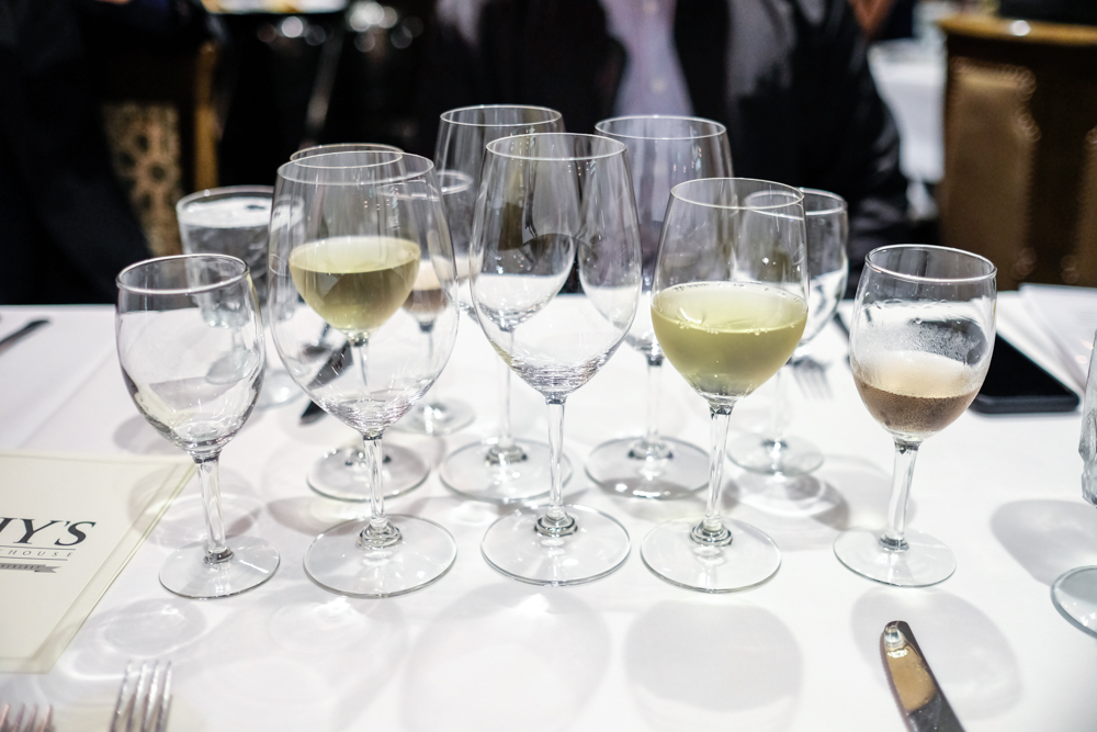 The collection of glasses in front of you may seem daunting, but you'll come to appreciate the sommelier selected wine pairings in no time.