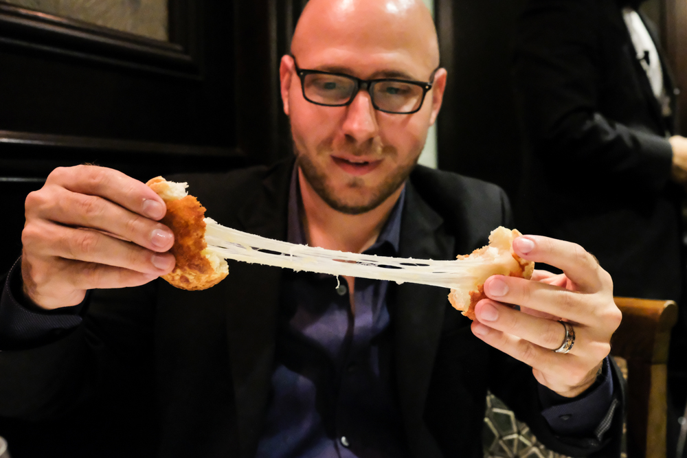 Billy giving us a droolworthy cheese-pull with Hy's new cheesy biscuits, a play on their classic cheese toast.