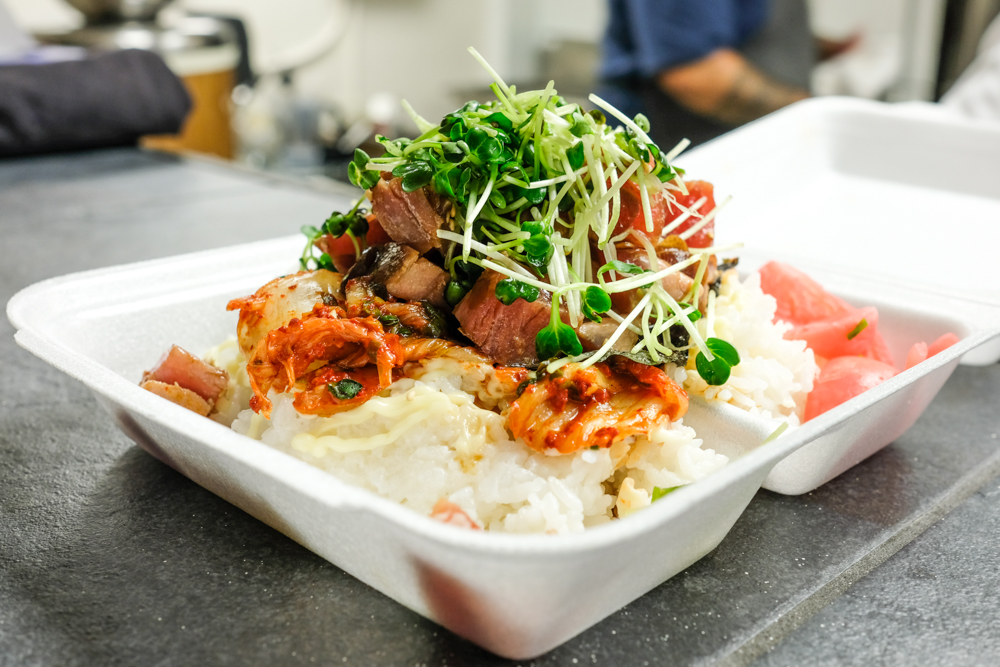 The kimchee ahi poke bowl is another towering creation with cubed ahi, wasabi aioli, and thick pieces of napa cabbage kimchee.
