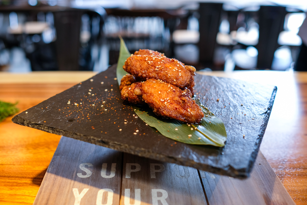 The umami shichimi chicken wings make for tasty bar fare.