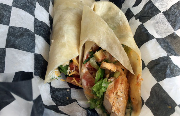 The Buffalo ranch chicken wrap ($7) includes grilled chicken breast, buffalo ranch sauce, lettuce, tomatoes and shredded cheese. Choose among a flour, spinach or tomato-flavored tortilla.