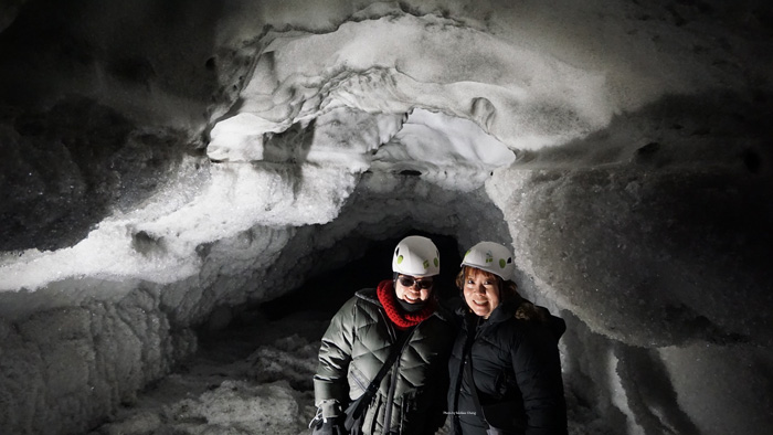 Deb and I hit the end of the cave — at least, the part that was safe. When the ice melts in the summer, the water comes out in such great force that it defies gravity and flows upward through this cave.