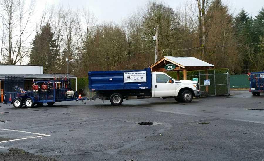 maintenance truck leaving the yard