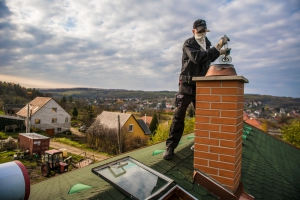 Chimney Cleaner on Roof