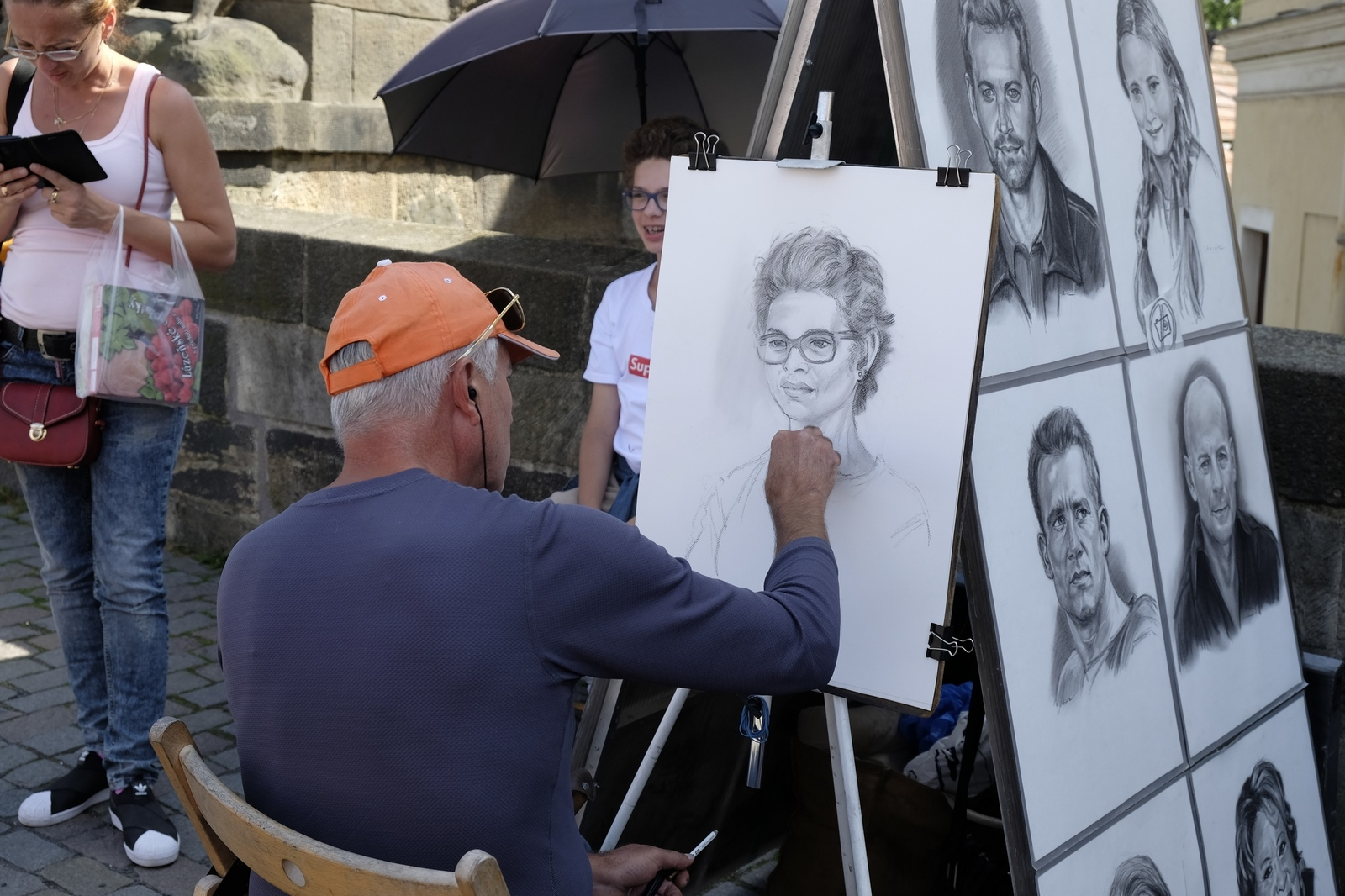 Watching an artist at work, Charles Bridge, Prague