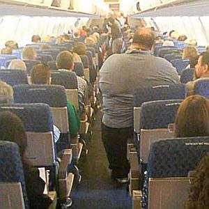 obese man in an airplane