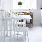 Tiny white kitchen interior with table