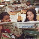 Students reading boston herald resized