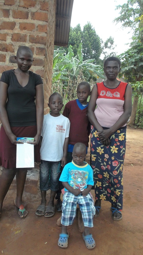 Alex with his family in his home village