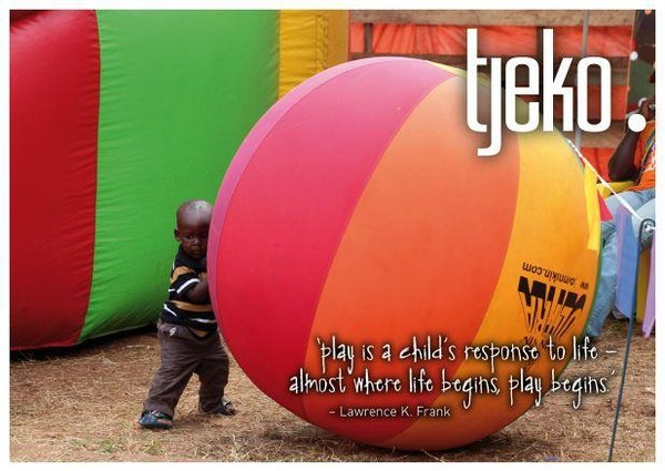 little child - big ball - play in Uganda