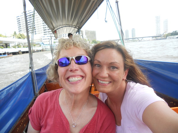 Cathy & Tricia cruising the river in Thailand, May 2013