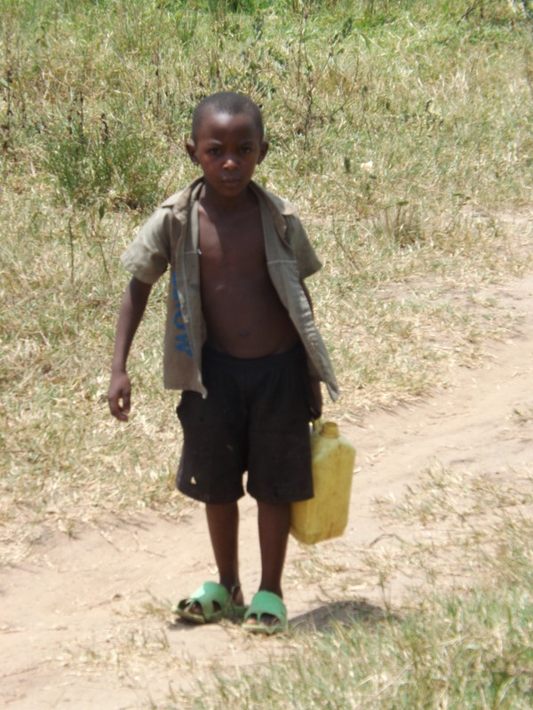 A young boy walks for miles to find drinking water that is not safe or clean.