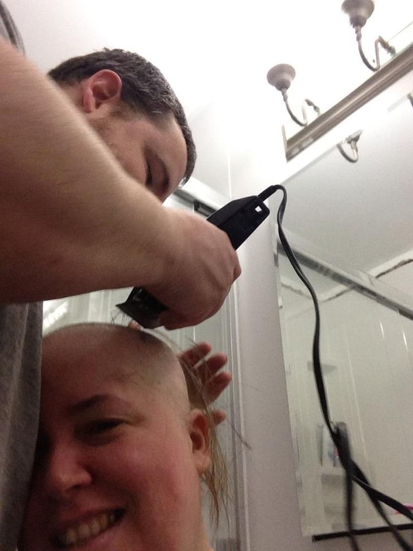 Ray shaving Jacqueline's head...she is such a trooper