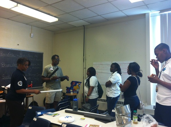 Students Training and Reviewing Materials for Weatherization Home Visits for the Summer