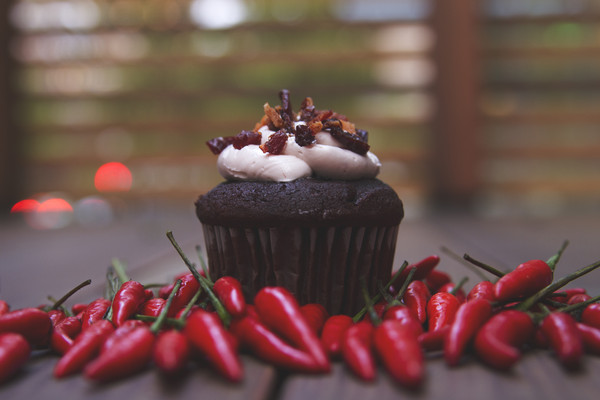 Chocolate Base - Ancho Chili Chocolate Ganache filling - Vanilla Buttercream Icing - Crumbled Bacon -