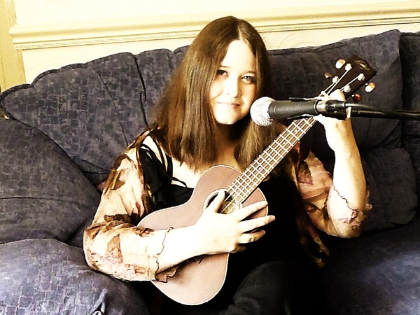 Me with my uke, doing a living room gig