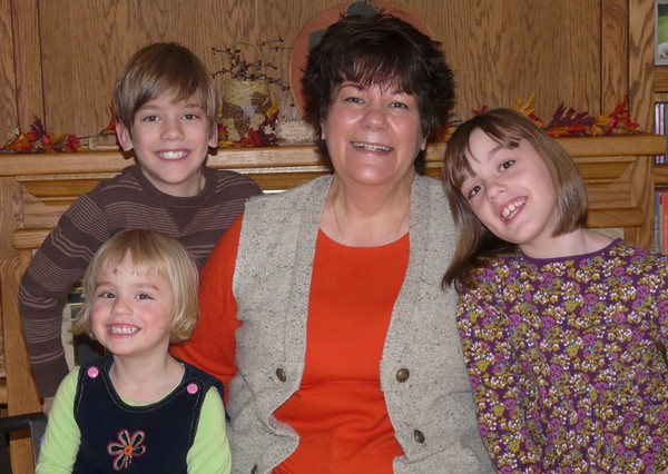 Sandy with 3 of her grandchildren
